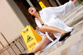 Lady slipping on tiles